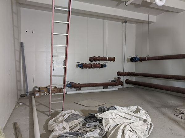 Pipes and a ladder inside a room