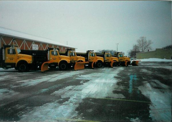 Parking Lot Full of Plow Trucks