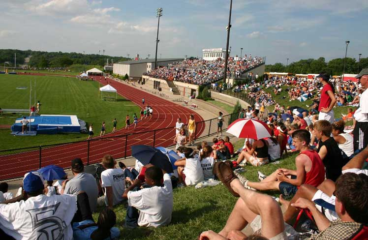 Crowd Watching a Track Meet from Bleachers