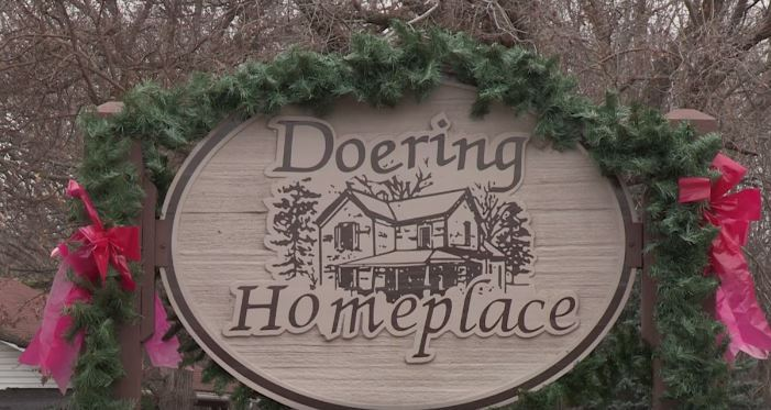 Sign at Doering Homeplace decorated with holiday garland